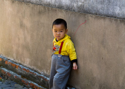 Little Boy at Wall